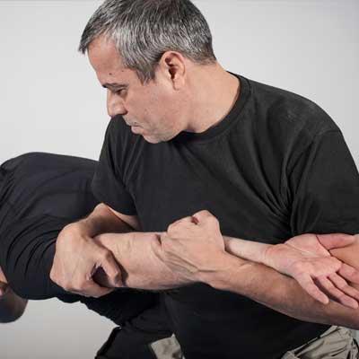 man fighting off attacker