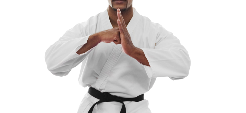 Adult man in karate uniform bowing